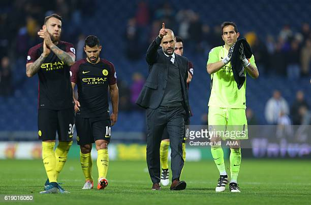 Josep Guardiola the manager of Manchester City points to the fans as the team applaud after the Premier League match between West Bromwich Albion and...
