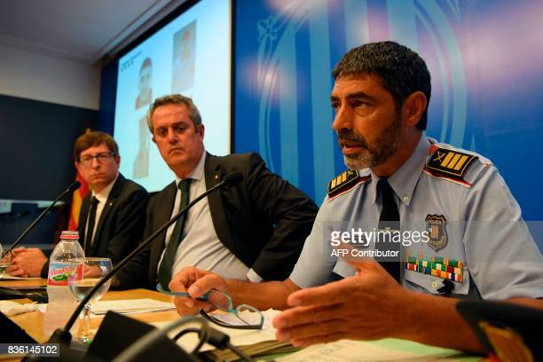 Josep Lluis Trapero chief of the Catalan regional police 'Mossos D'Esquadra' speaks past Interior Minister for the Catalan government Joaquim Forn...