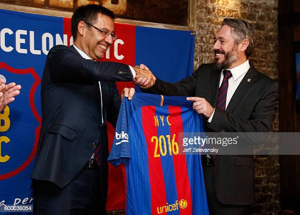 Josep Maria Bartomeu President of FC Barcelona gifts a personalized team jersey to Jordi GetmanEraso President of Penya FC Barcelona New York City at...