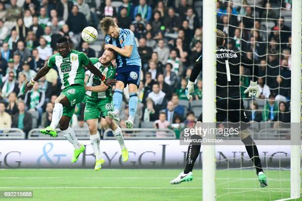 Joseph Aidoo and Mats Solheim of Hammarby IF and Jacob Une Larsson in a header duel during the Allsvenskan match between Hammarby IF and Djurgardens...