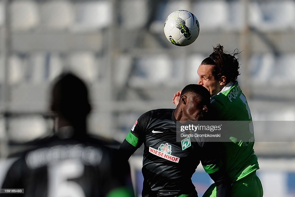 Joseph Akpala of Bremen and Emanuel Pogatetz of Wolfsburg go up for a header during the friendly match between Werder Bremen and VfL Wolfsburg at Mardan Palace Stadium on January 9, 2013 in Kundu, Turkey.