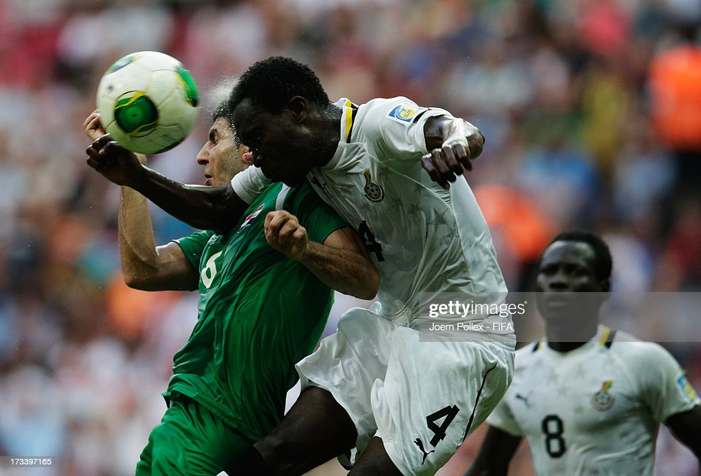 Joseph Attamah (C) of Ghana and Mohanad Abdulraheem of Iraq compete for the ball during the FIFA U-20 World Cup 3rd Place playoff match between Ghana and Iraq at Ali Sami Yen Arena on July 13, 2013 in Istanbul, Turkey.