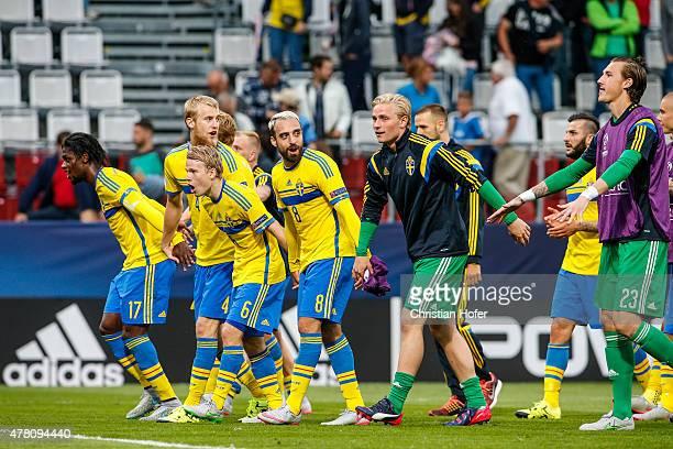 Joseph Baffo Filip Helander Oscar Lewicki Abdullah Khalili goalkeeper Jacob Rinne and goalkeeper Andreas Linde of Sweden celebrate after winning the...