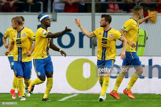 Joseph Baffo of Braunschweig celebrates the first goal with Quirin Moll of Braunschweigduring the Second Bundesliga match between Fortuna Duesseldorf...