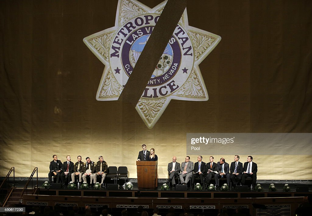 Joseph Beck, center left, and Elizabeth Krmpotich speak during a memorial service for their brother Las Vegas Metropolitan Police Officer Alyn Beck at The Smith Center for the Performing Arts Saturday, on June 14, 2014 in Las Vegas, Nevada. Police said Beck and Officer Igor Soldo were shot and killed on June 8 at a restaurant by Jerad Miller and his wife Amanda Miller. Police said the Millers then went into a nearby Wal-Mart where Amanda Miller killed Joseph Wilcox before police killed Jerad Miller and Amanda Miller killed herself.