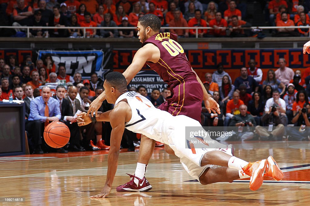 Joseph Bertrand #2 of the Illinois Fighting Illini dives for the ball against Julian Welch #00 of the Minnesota Golden Gophers during the game at Assembly Hall on January 9, 2013 in Champaign, Illinois.