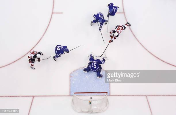 Joseph Blandisi of the New Jersey Devils goes to the net against Curtis McElhinney of the Toronto Maple Leafs during the first period at the Air...