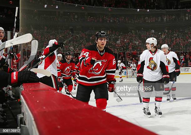 Joseph Blandisi of the New Jersey Devils returns to the bench after scoring his first NHL goal against the Ottawa Senators at the Prudential Center...