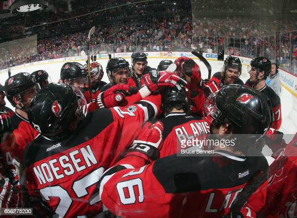 Joseph Blandisi of the New Jersey Devils scores at 405 of overtime to defeat the New York Rangers 32 at the Prudential Center on March 21 2017 in...
