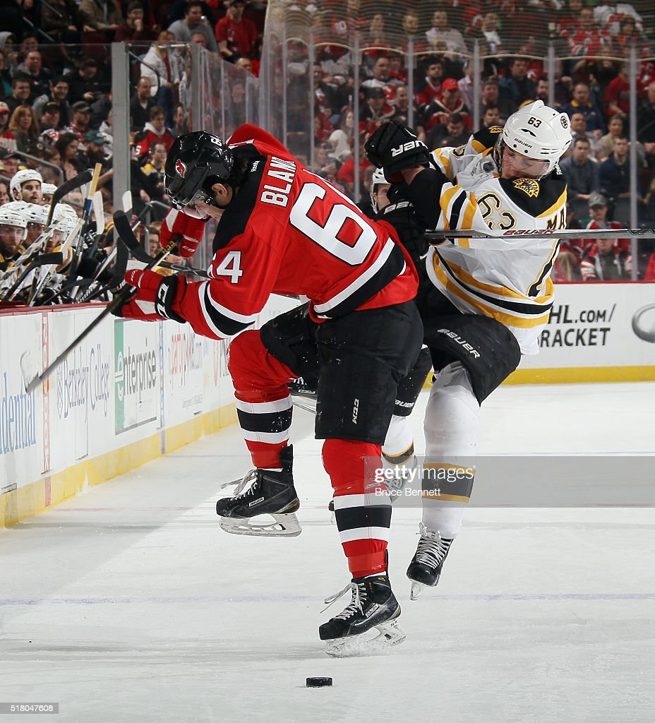 Joseph Blandisi of the New Jersey Devils steps into Brad Marchand of the Boston Bruins during the first period at the Prudential Center on March 29...