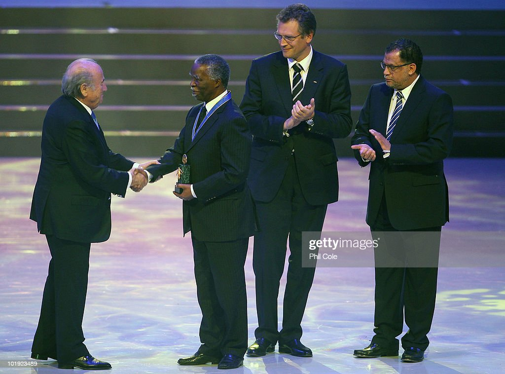 Joseph Blatter President (L) of FIFA and Jerome Valcke Secretary General of FIFA award <a gi-track='captionPersonalityLinkClicked' href=/galleries/search?phrase=Thabo+Mbeki&family=editorial&specificpeople=160910 ng-click='$event.stopPropagation()'>Thabo Mbeki</a> (2ndL) former President of South Africa with the FIFA order of Merit during the FIFA Congress Opening Ceremony at the Gallagher Convention Centre on June 9, 2010 inJohnesburg, South Africa.
