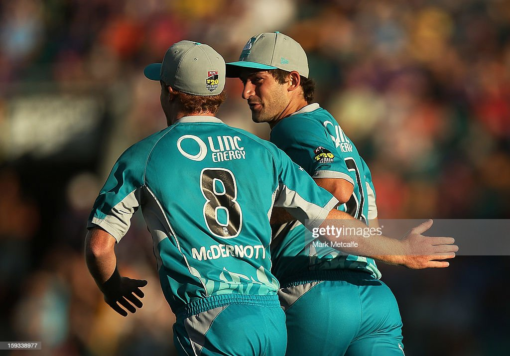 Joseph Burns of the Heat celebrates with teammate Alister McDermott after taking the wicket of Travis Birt of the Hurricanes during the Big Bash League match between the Hobart Hurricanes and the Brisbane Heat at Blundstone Arena on January 12, 2013 in Hobart, Australia.