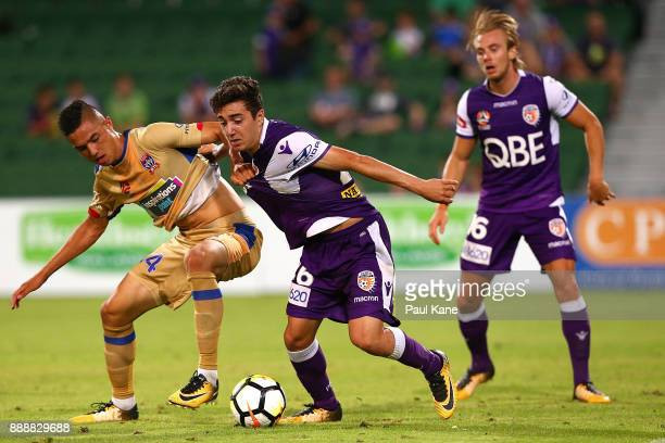 Joseph Champness of the Jets and Jacob Italiano of the Glory contest for the ball during the round 10 ALeague match between the Perth Glory and the...
