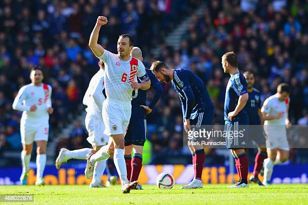 Joseph Chipolina of Gibraltar celebrates after Lee Casciaro of Gibraltar scored their first goal during the EURO 2016 Qualifier match between...