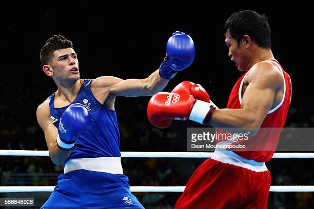 Joseph Cordina of Great Britain exchanges blows with Charly Coronel Suarez of Philippines during their Men's Light 60 kg Preliminary bout on Day 1 of...
