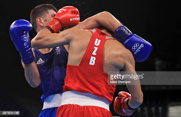 Joseph Cordina of Great Brittain fights Hurshid Tojibaev of Uzbekistan in their Mens Lightweight 60kg bout on Day 4 of the Rio 2016 Olympic Games at...