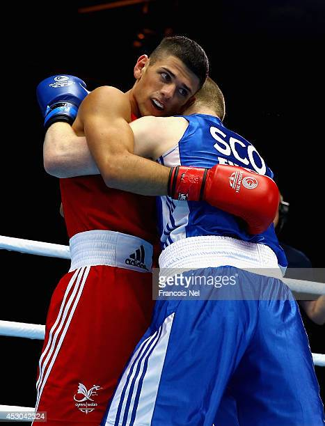 Joseph Cordina of Wales competes with Charlie Flynn of Scotland during the Men's Light 60kg SemiFinals Boxing at Scottish Exhibition And Conference...