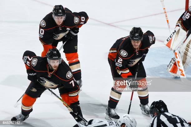 Joseph Cramarossa Kevin Bieksa and Corey Perry of the Anaheim Ducks line up for a faceoff during the game against the Los Angeles Kings on February...