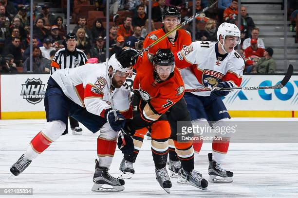 Joseph Cramarossa of the Anaheim Ducks battles for position against Aaron Ekblad and Gregg McKegg of the Florida Panthers during the game on February...