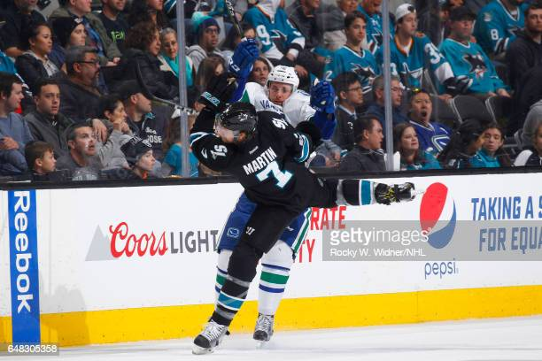 Joseph Cramarossa of the Vancouver Canucks collides into Paul Martin of the San Jose Sharks at SAP Center on March 2 2017 in San Jose California