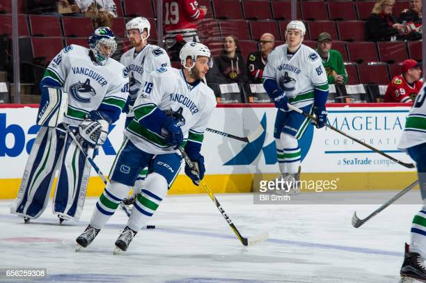 Joseph Cramarossa of the Vancouver Canucks warms up with teammates prior to the game against the Chicago Blackhawks at the United Center on March 21...