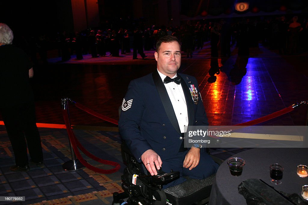 Joseph Deslauriers, technical sergeant in the U.S. Air Force who was injured in 2011 in Afghanistan, attends the Commander-in- Chief Ball at the Walter E. Washington Convention Center in Washington, D.C., U.S., on Monday, Jan. 21, 2013. President Obama was sworn in for his second term earlier in the day. Photographer: Stephanie Green/Bloomberg via Getty Images