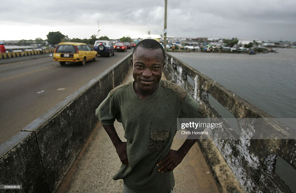 Joseph Duo, 28, a former Liberian government soldier, stands on a bridge where he often fought battles during the Liberian civil war October 10, 2005 in Monrovia, Liberia. A picture of Duo jumping into the air in exultation during a battle with rebel forces in 2003 was distributed around the world, making him a symbol of the intractable difficulties of Liberia's long civil war. Duo, now de-commissioned and unemployed, lives in a squalid neighborhood on the outskirts of Monrovia with a wife and three children. He is now considering finishing high school, since he left school in the 10th grade to become a child soldier.