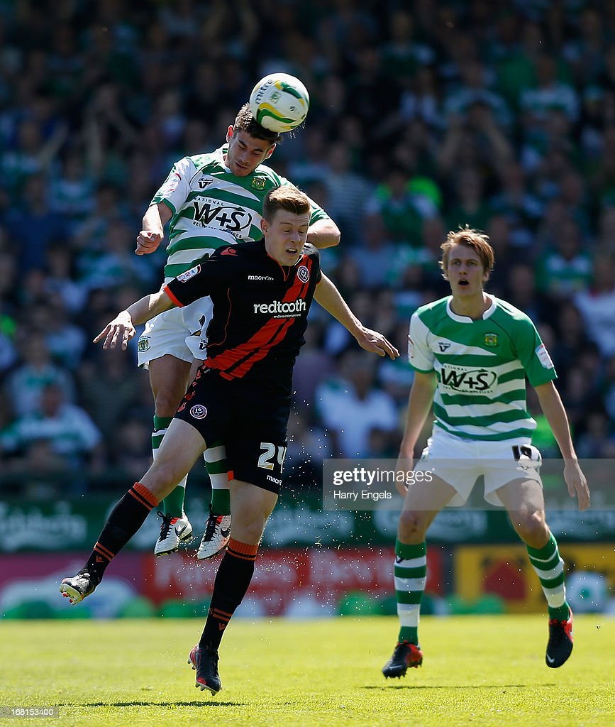 Joseph Edwards of Yeovil Town (L) beats Joe Ironside of Sheffield United to a header during the npower League One Play Off Semi Final second leg match between Yeovil Town and Sheffield United at Huish Park on May 6, 2013 in Yeovil, England.
