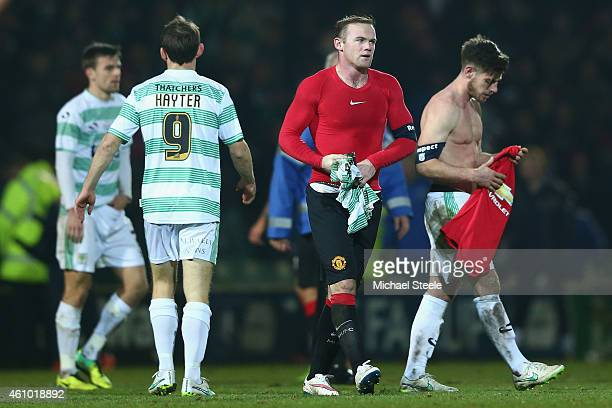 Joseph Edwards of Yeovil Town cuts a dejected figure after swapping shirts with Wayne Rooney of Manchester after his sides 02 defeat during the FA...