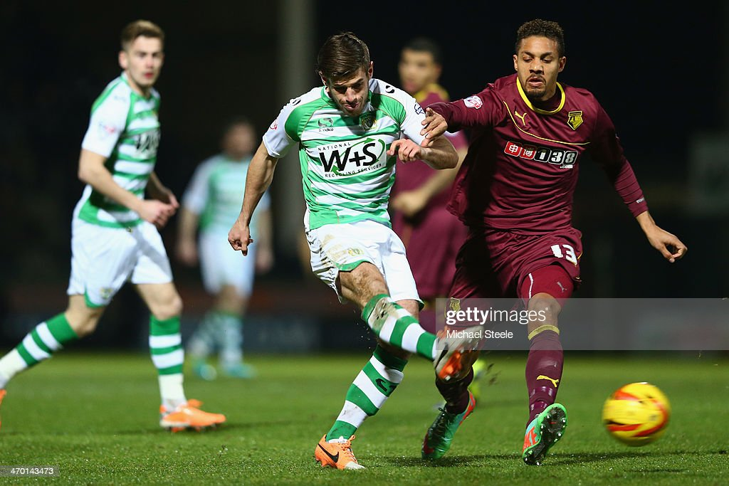 Joseph Edwards (L) of Yeovil Town shoots as <a gi-track='captionPersonalityLinkClicked' href=/galleries/search?phrase=Mathias+Ranegie&family=editorial&specificpeople=8283787 ng-click='$event.stopPropagation()'>Mathias Ranegie</a> (R) of Watford closes in during the Sky Bet Championship match between Yeovil Town and Watford at Huish Park on December 03, 2013 in Yeovil, England,