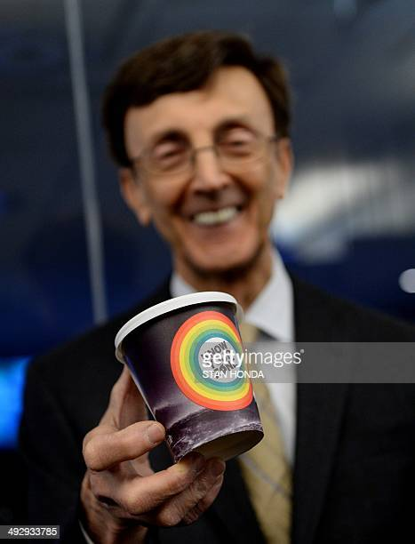 Joseph F Bruno commissioner New York City Office of Emergency Management holds a prototype coffee cup with the 'Know Your Zone' logo as NOAA issues...