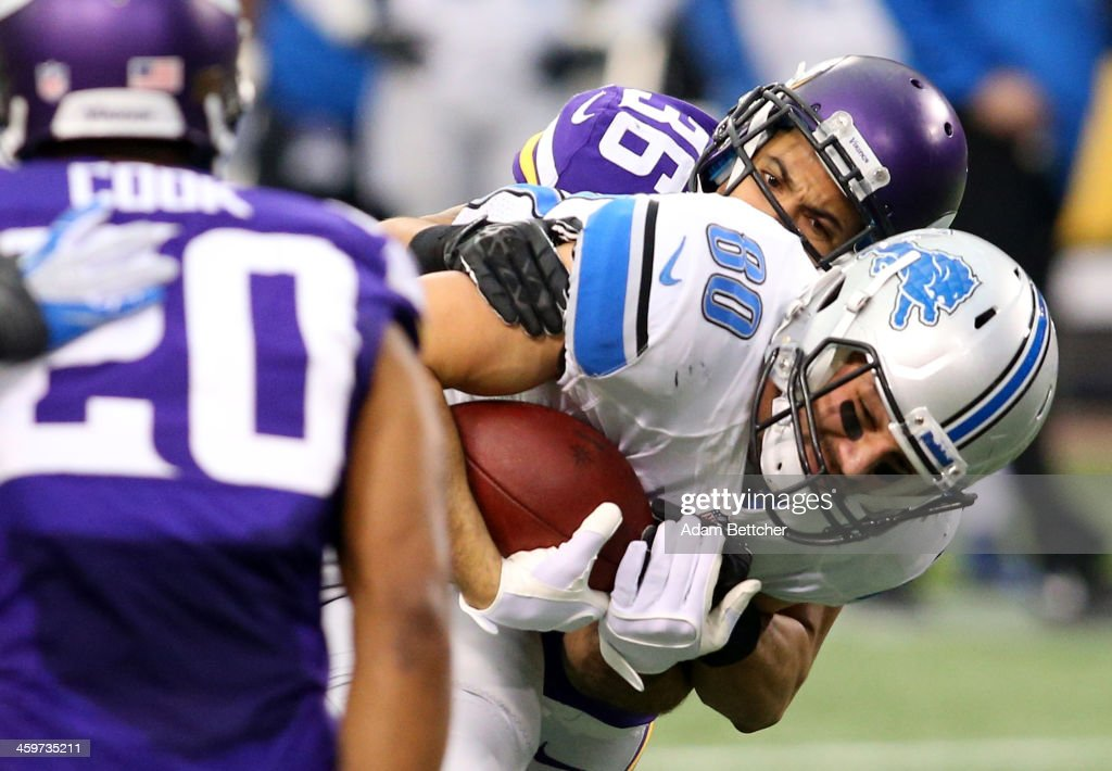 <a gi-track='captionPersonalityLinkClicked' href=/galleries/search?phrase=Joseph+Fauria&family=editorial&specificpeople=7322073 ng-click='$event.stopPropagation()'>Joseph Fauria</a> #80 of the Detroit Lions gets tackled by <a gi-track='captionPersonalityLinkClicked' href=/galleries/search?phrase=Robert+Blanton&family=editorial&specificpeople=5525793 ng-click='$event.stopPropagation()'>Robert Blanton</a> #36 of the Minnesota Vikings on December 29, 2013 at Mall of America Field at the Hubert H. Humphrey Metrodome in Minneapolis, Minnesota.