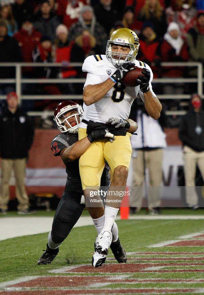 Joseph Fauria #8 of the UCLA Bruins scores a touchdown during the second quarter of play against the Washington State Cougars at Martin Stadium on November 10, 2012 in Pullman, Washington.