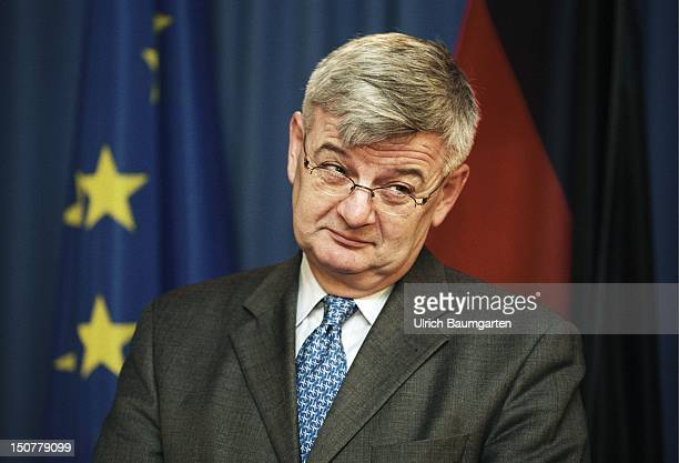 Joseph FISCHER Federal Minister for Foreign Affairs during a press conference in the Foreign Affairs Office In the background flags of Germany and...