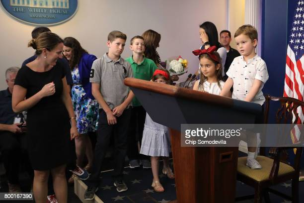 Joseph Frederick Kushner his sister 5yearold Arabella Rose Kushner and friends play with the lecturn in the James Brady Press Briefing Room following...