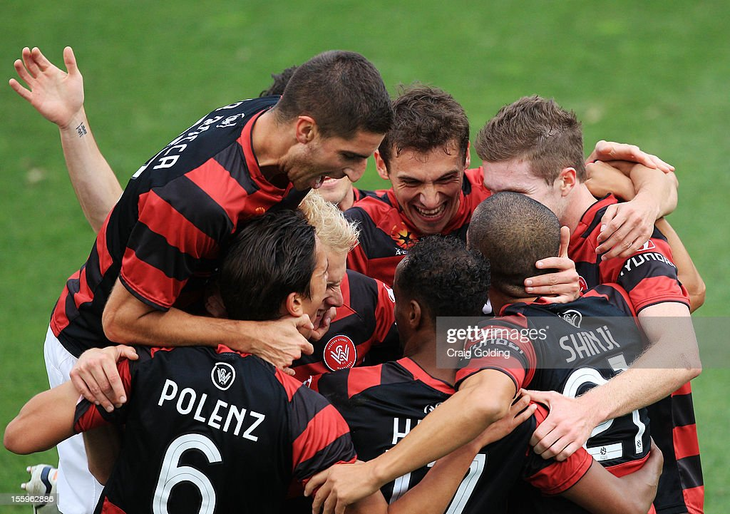 Joseph Gibbs celebrate with Wanderers team mates after scoring a goal during the round six A-League match between the Western Sydney Wanderers and the Newcastle Jets at Parramatta Stadium on November 10, 2012 in Sydney, Australia.
