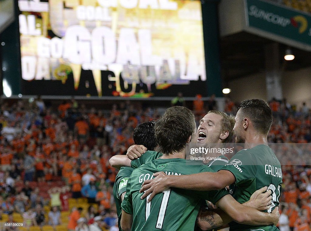 Joseph Gibbs of the Jets celebrates with team mates after scoring a goal to seal the match during the round 11 A-League match between Brisbane Roar and the Newcastle Jets at Suncorp Stadium on December 20, 2013 in Brisbane, Australia.