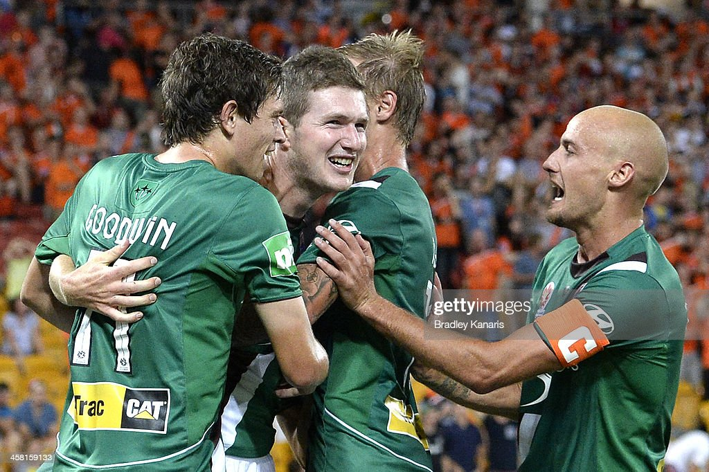 Joseph Gibbs of the Jets celebrates with team mates after scoring a goal to seal victory during the round 11 A-League match between Brisbane Roar and the Newcastle Jets at Suncorp Stadium on December 20, 2013 in Brisbane, Australia.