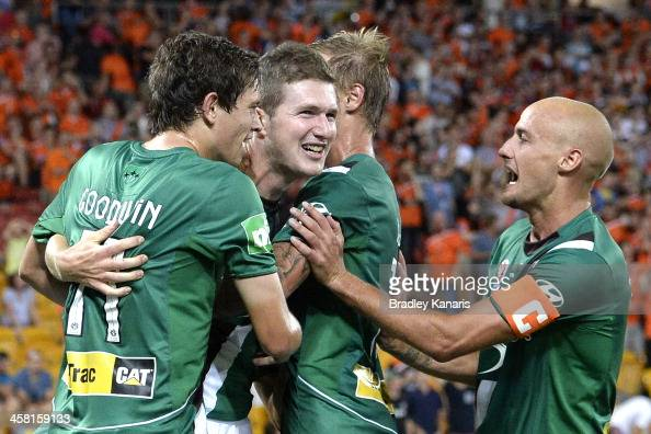 Joseph Gibbs of the Jets celebrates with team mates after scoring a goal to seal victory during the round 11 ALeague match between Brisbane Roar and...