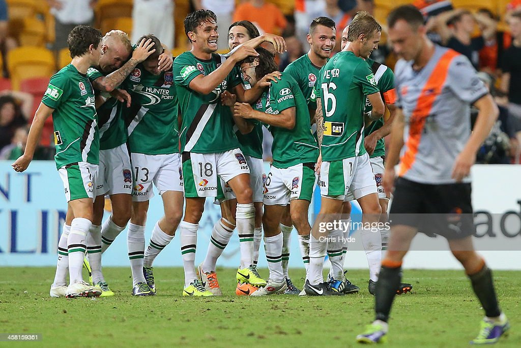Joseph Gibbs of the Jets celebrates with team mates after scoring a goal during the round 11 A-League match between Brisbane Roar and the Newcastle Jets at Suncorp Stadium on December 20, 2013 in Brisbane, Australia.