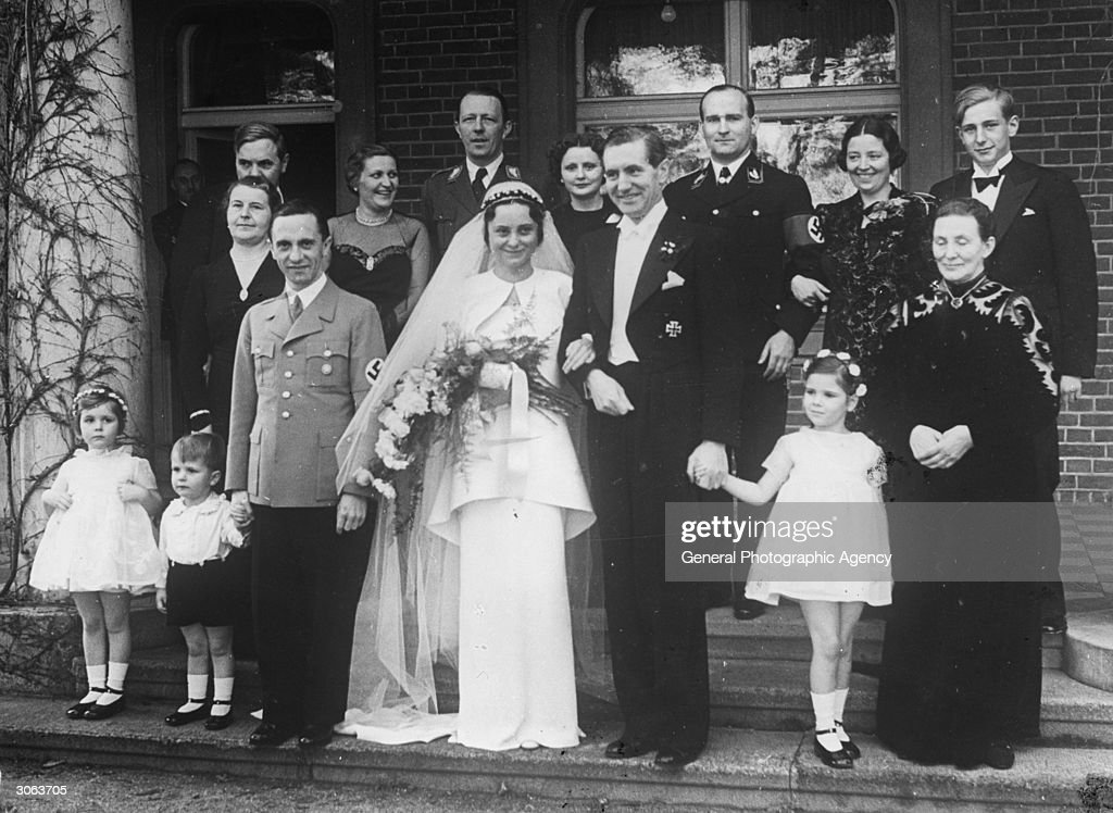 Joseph Goebbels (1897 - 1945) at a family wedding, he is standing on the bride's right.