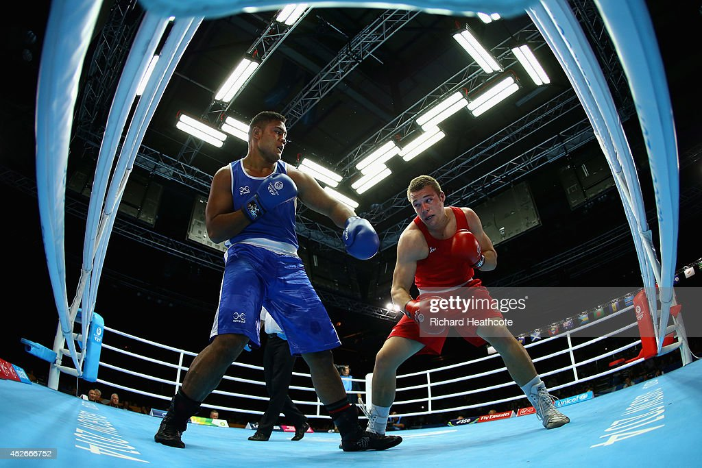 Joseph Goodhall of Australia (red) in action against Patrick Mailata of New Zealand in the Men's Super Heavy +91kg preliminaries at Scottish Exhibition And Conference Centre during day two of the Glasgow 2014 Commonwealth Games on July 25, 2014 in Glasgow, United Kingdom.