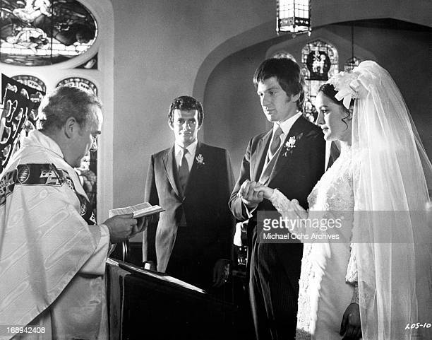 Joseph Hindy watches as Michael Brandon and Bonnie Bedelia are married in a scene from the film 'Lovers And Other Strangers' 1970