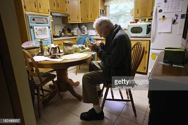 Joseph Horecky 90 and with a vision impairment makes a call from his kitchen after receiving a 'Meals on Wheels' delivery from the Sullivan County...