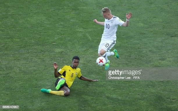 Joseph Iaruel of Vanuatu clears from Philipp Ochs of Germany during the FIFA U20 World Cup Korea Republic 2017 group B match between Germany and...