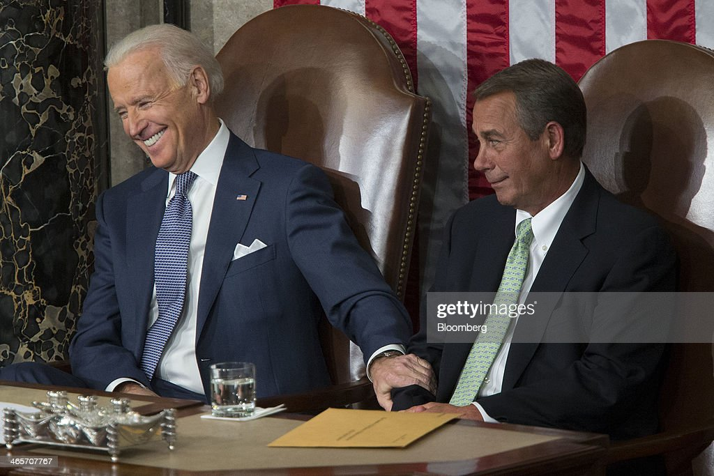 Joseph 'Joe' Biden, U.S. vice president, left, holds onto House Speaker <a gi-track='captionPersonalityLinkClicked' href=/galleries/search?phrase=John+Boehner&family=editorial&specificpeople=274752 ng-click='$event.stopPropagation()'>John Boehner</a>, a Republican from Ohio, as U.S. President Barack Obama, not pictured, delivers the State of the Union address to a joint session of Congress at the Capitol in Washington, D.C., U.S., on Tuesday, Jan. 28, 2014. Obama offered modest steps to chip away at the country's economic and social challenges in a State of the Union address that reflects the limits of his power to sway Congress. Photographer: Andrew Harrer/Bloomberg via Getty Images