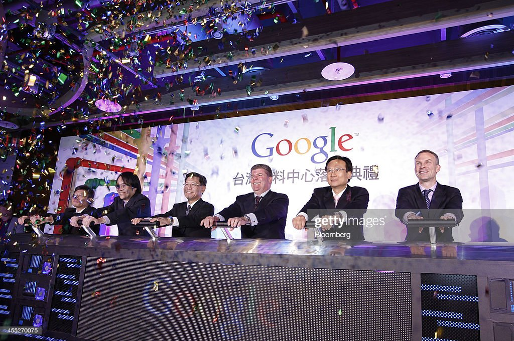 Joseph 'Joe' Kava, head of data centers at Google Inc., third from right, and Scott Beaumont, head of Greater China at Google Inc., first right, attend the opening ceremony of the Google data center in Changhua, Taiwan, on Wednesday, Dec. 11, 2013. Google, owner of the worlds most-popular search engine, doubled its spending plan for a new data center in Taiwan to $600 million amid surging demand from Asia for its Gmail and YouTube services. Photographer: Ashley Pon/Bloomberg via Getty Images
