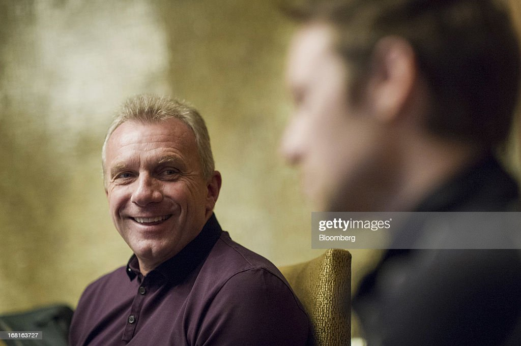 Joseph 'Joe' Montana, co-founder of iMFL and retired National Football League (NFL) quarterback, left, laughs as Damon Grow, co-founder of iMFL, right, speaks during an interview in San Francisco, California, U.S. on Tuesday, April 30, 2013. iMFL, a fantasy football application that will be available for download at the Apple Inc. App Store, will be released before the start of the 2013 NFL season. Photographer: David Paul Morris/Bloomberg via Getty Images