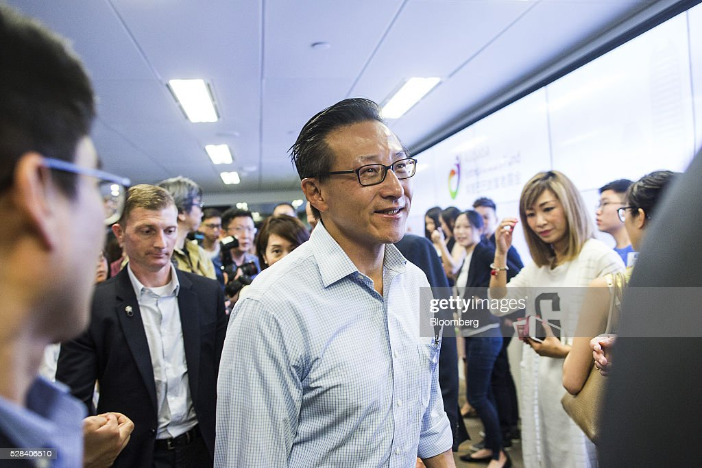 Joseph 'Joe' Tsai, co-vice chairman of Alibaba Group Holding Ltd., center, leaves a news conference in Hong Kong, China, on Thursday, May 5, 2016. Alibaba's HK$1 billion fund for Hong Kong entrepreneurs is investing in GoGoVan, a hauling and delivery service that's one of the city's biggest startups, and other online services. Photographer: Justin Chin/Bloomberg via Getty Images