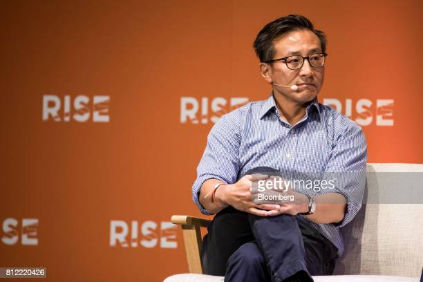 Joseph 'Joe' Tsai covice chairman of Alibaba Group Holding Ltd listens during the Rise conference in Hong Kong China on Tuesday July 11 2017 Stripe...